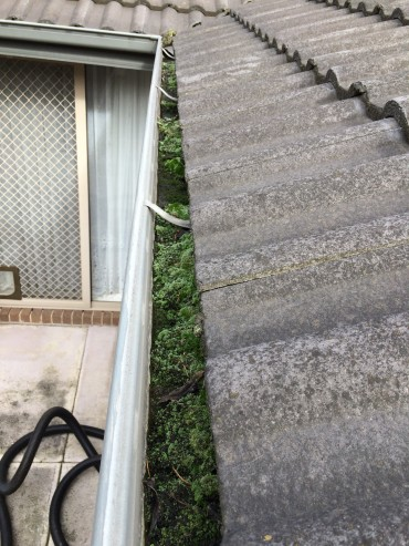 BEFORE - GUTTER CLEANING